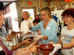 Volunteers dispersing soup